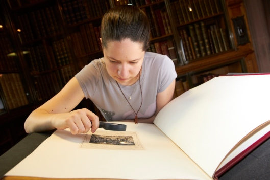 Lavinia Hutanu examining the copy of the Book of Job which she found in the collection.