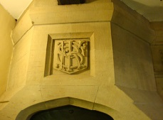 Initials carved over the Gawthorpe kitchen hearth. Photo credit: Jane Speller.