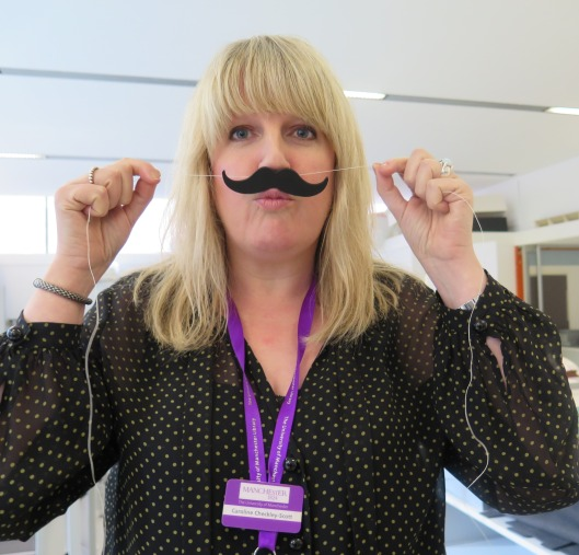 Caroline Checkley-Scott testing the fitting of the moustache