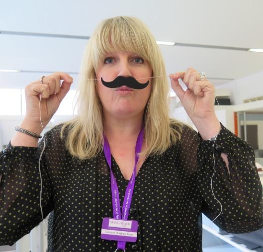 Caroline Checkley-Scott testing the fitting of the moustache