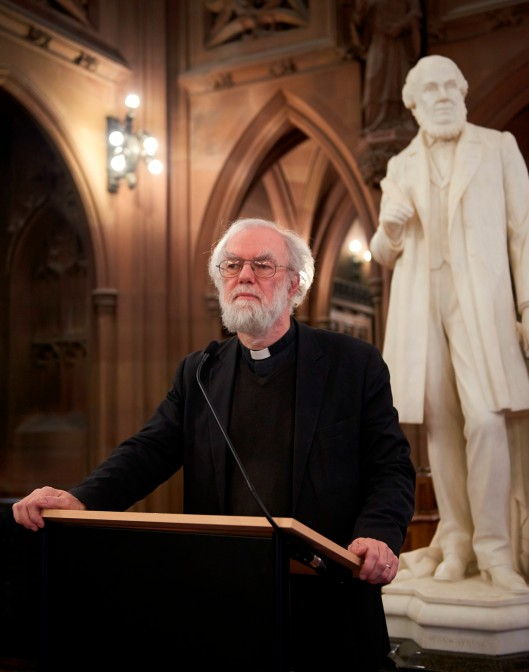 Rowan Williams delivering the Rylands Poetry Reading.