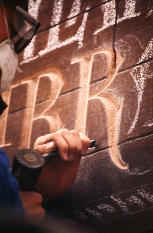 Letter carving in progress