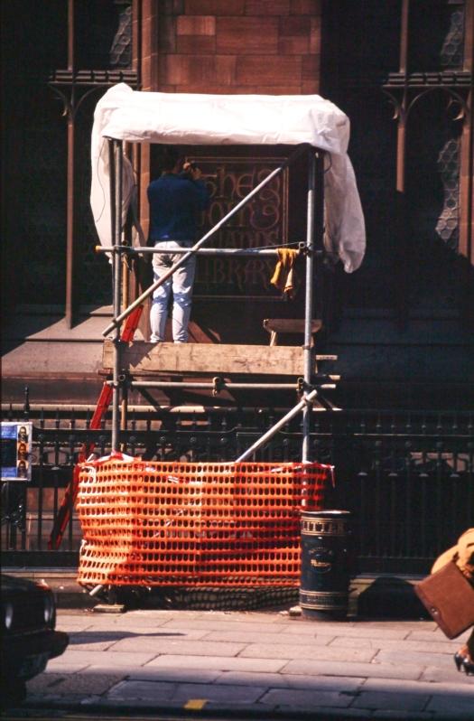 A carver working on a platform