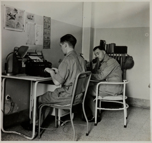 G. A. G. Mitchell (right) at his desk in Cairo, 1942 (Mitchell Papers, GGM/3/1).