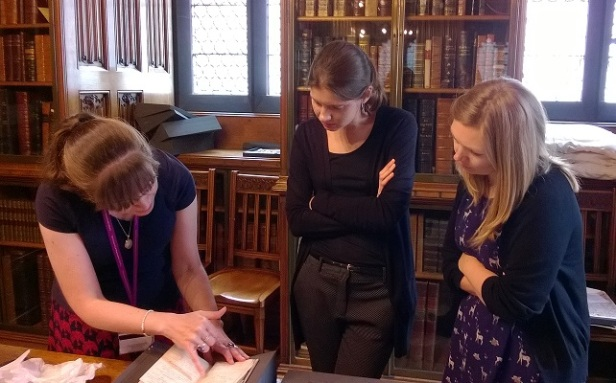 l to r: Fran Baker, Philippa Mole and Helen Swainger examine the Peterloo relief fund account book. Photograph by Jane Speller.