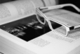 Image of a pair of glasses on a book