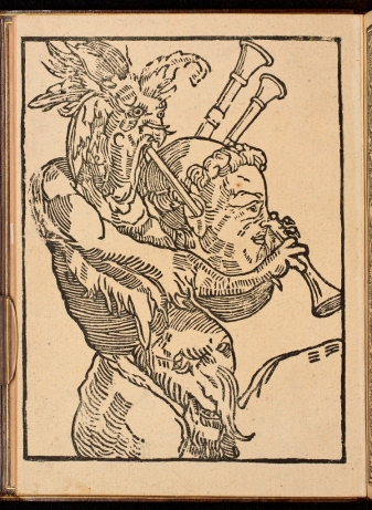 A woodcut image of Luther being played, as an instrument, by the devil.