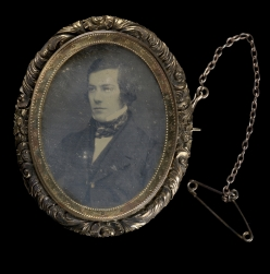 Photographic brooch, containing a daguerreotype portrait of a young man.
